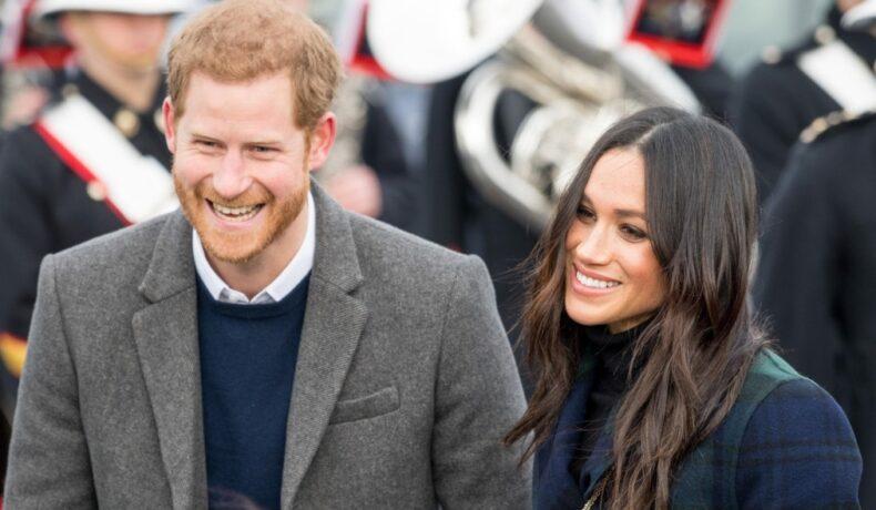 Meghan Markle și Prințul Harry surprinși zâmbind în timpul unui eveniment oficial