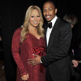 Mariah Carey este alături de Nick Cannon. Ea poartă o rochie vișinie cu fundă în față, are părul lung, lăsat pe spate, în buble lejere. El este într-un costum negru, cu o cămașă albă și un papion negru și își ține mâna pe burta ei.