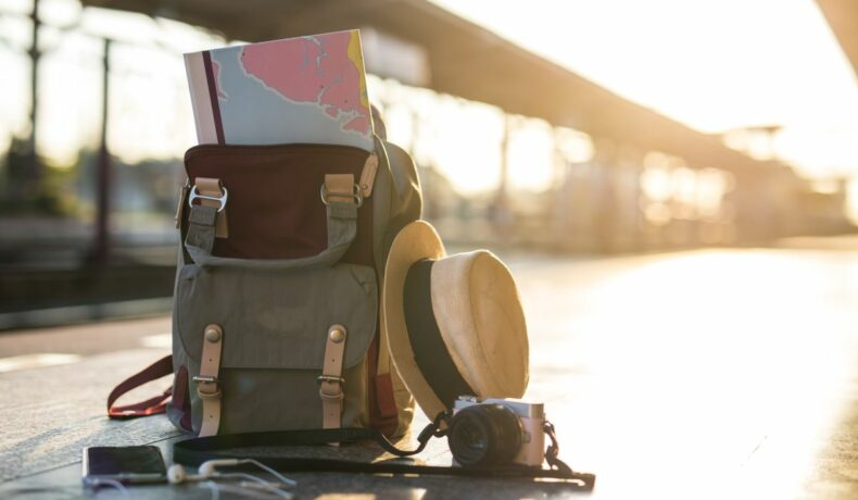 Map,In,Backpack,,mobile,Phone,With,Earphone,And,Hat,At