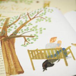 Un tată și un fiu, care stau pe o bancă și hrănesc păsărele, într-un dintre ilustrațiile din The Bench, cartea scrisă de Meghan Markle