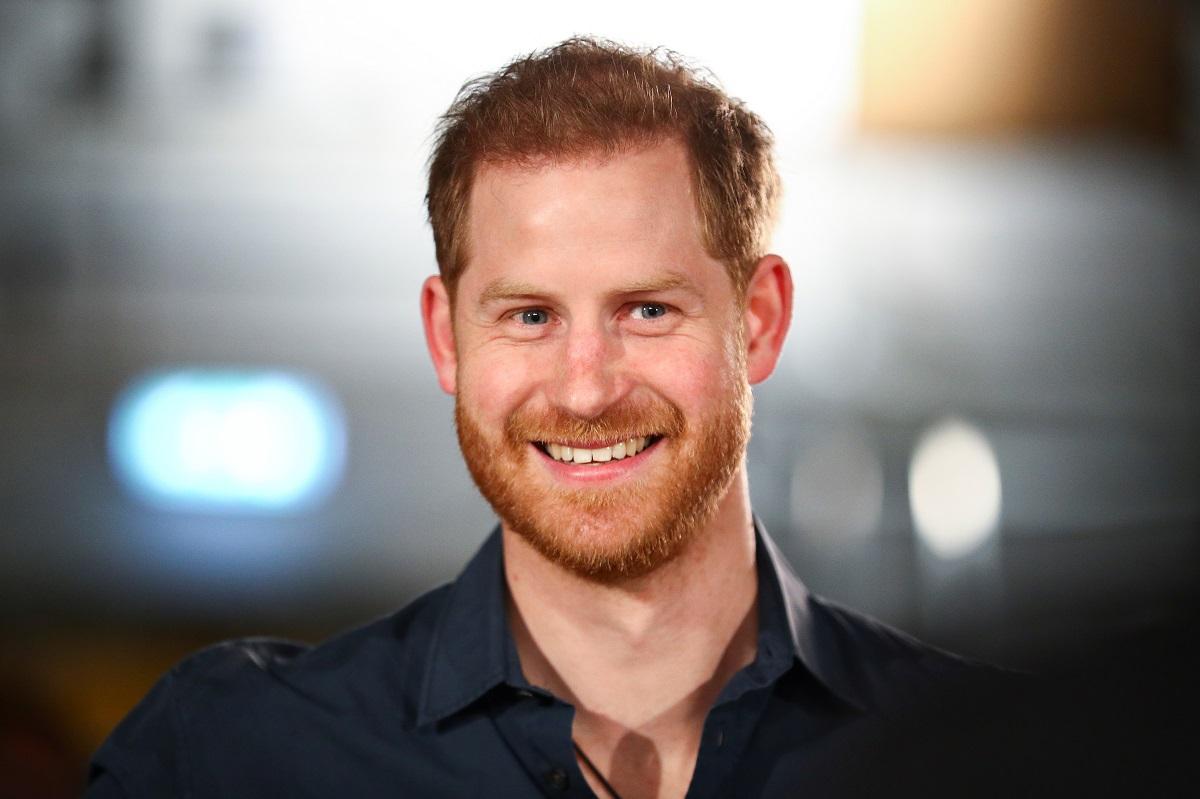 Portret al Prințului Harry care zâmbește și vrea să-și boteze fiica la Castelul Windsor