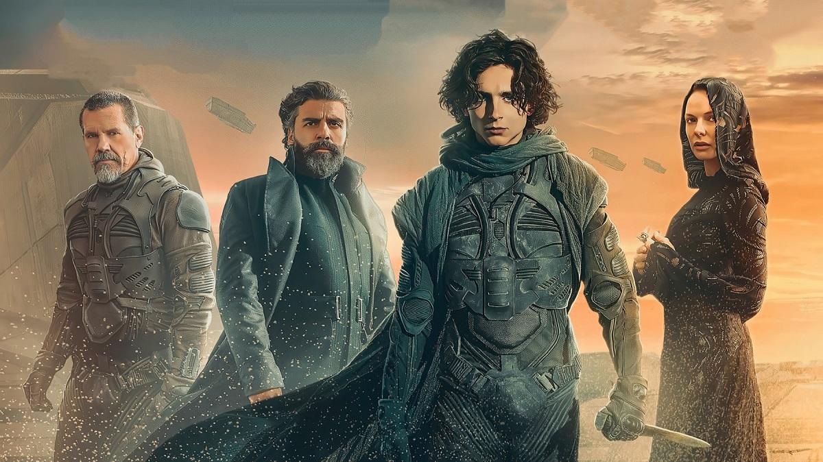 Actorii principali din filmul Dune îmbrăcați la costume, Zendaya și Timothee Chalamet, într-o scenă emblematică pentru film