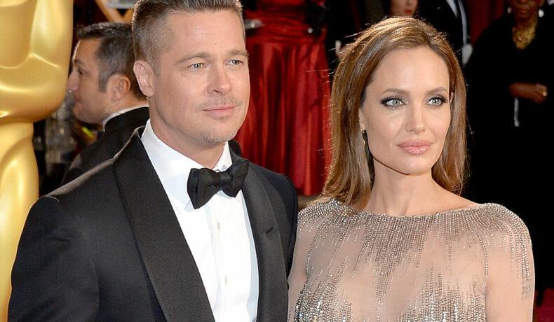 Angelina Jolie și Brad Pitt, la Annual Academy Awards, pe covorul roșu, în 2014