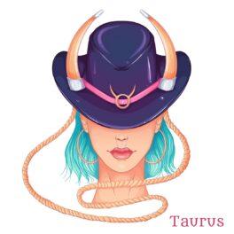 O femeie frumoasă care poartă o pălărie cu coarne de taur pentru a reprezenta zodia taurului
